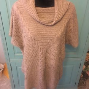 Short sleeved cowl neck ribbed sweater.